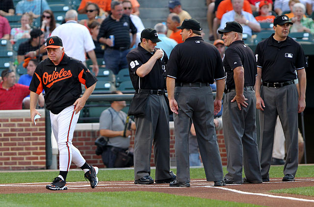 640px-Buck_Showalter_and_umpires