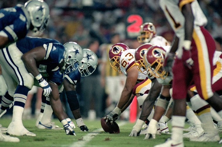 WASHINGTON - SEPTEMBER 6: The Washington Redskins offense lines up against the Dallas Cowboys during the NFL game at RFK Stadium on September 6, 1993 in Washington, D.C. The Redskins defeated the Cowboys 35-16.