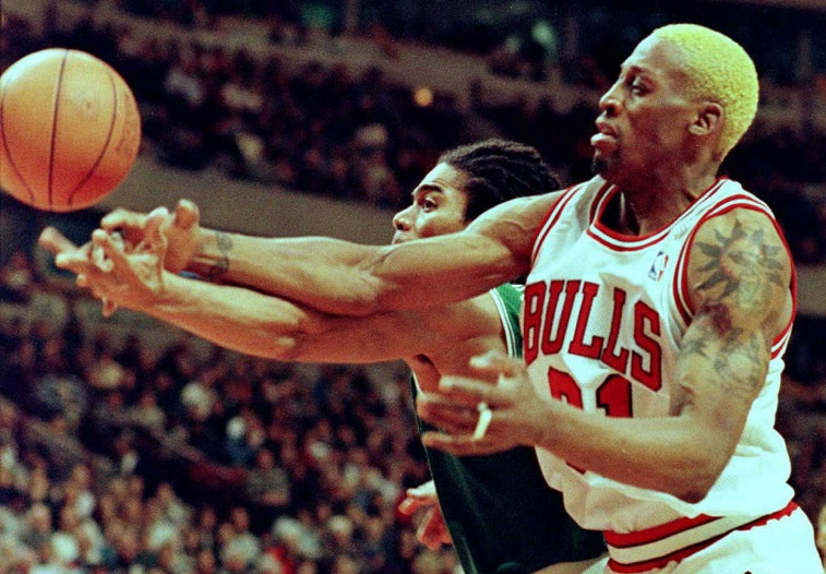 Dennis Rodman fights for control of the ball during a game