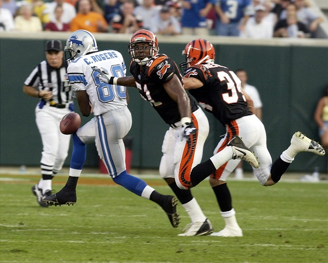 Charles Rogers drops the ball as Bengals defenders catch up with him.
