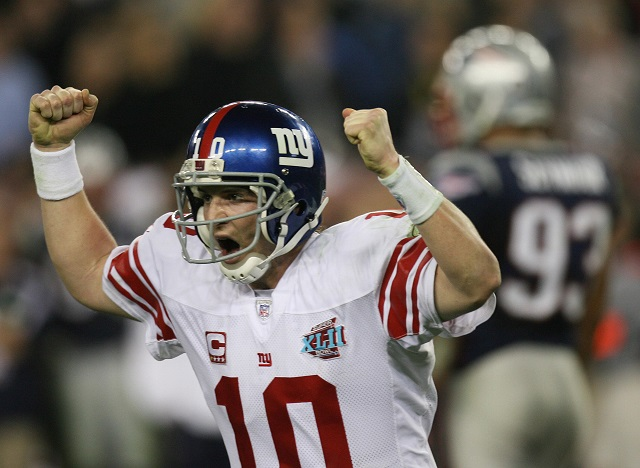 Eli Manning screams as he wins the Super Bowl.