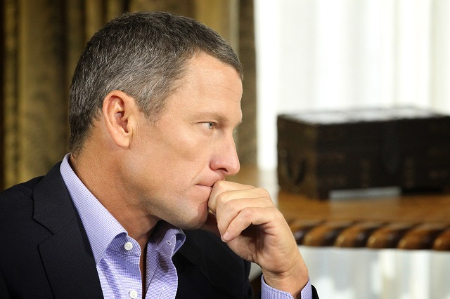 Lance Armstrong looks serious during an interview