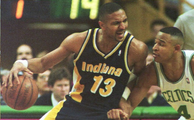 Mark Jackson attempts to get past the defender.