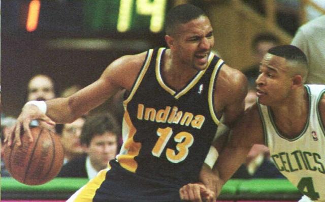 Mark Jackson moves past a Celtics defender.