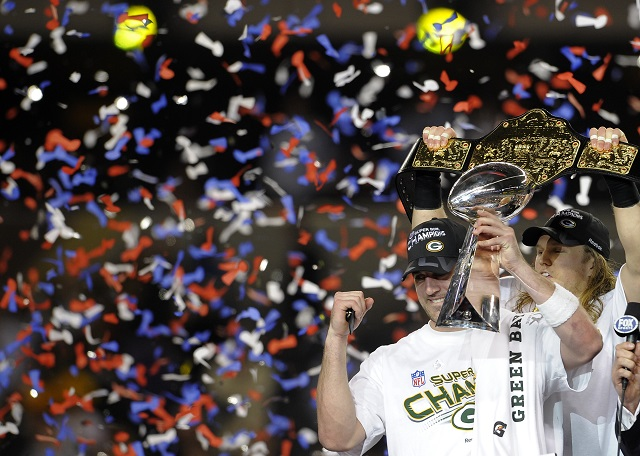 Green Bay QB Aaron Rodgers holds the Lombardi Trophy after winning the Super Bowl.