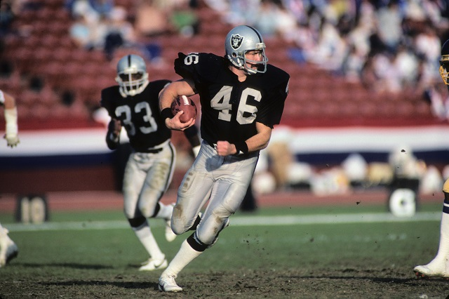 Tight end Todd Christensen of the Los Angeles Raiders runs the ball.
