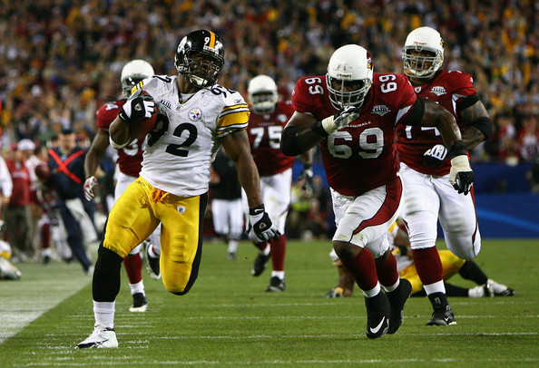 James Harrison runs as fast as he can.