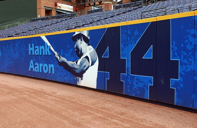 The Milwaukee Brewers pay homage to Hank Aaron with a sign.