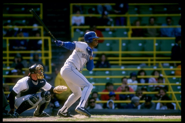 Ken Griffey Jr. gets ready to run to first base.