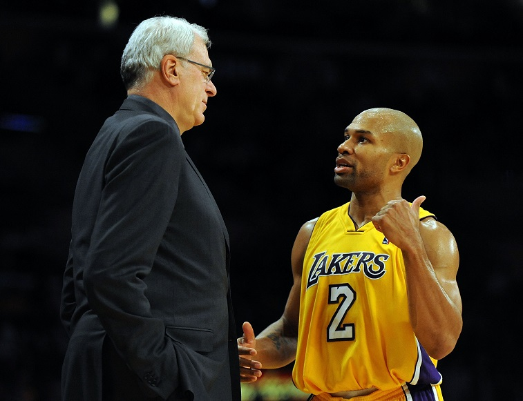 LOS ANGELES, CA - DECEMBER 01: Derek Fisher #2 of the Los Angeles Lakers speaks to Head Coach Phil Jackson during the game against the New Orleans Hornets at Staples Center on December 1, 2009 in Los Angeles, California. (Photo by Harry How/Getty Images) NOTE TO USER: User expressly acknowledges and agrees that, by downloading and/or using this Photograph, user is consenting to the terms and conditions of the Getty Images License Agreement.