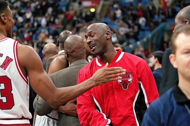 Michael Jordan congratulates a teammate.