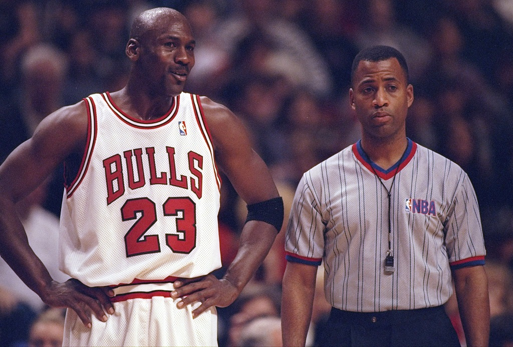 27 Dec 1997: Guard Michael Jordan of the Chicago Bulls confers with an official during a game against the Atlanta Hawks at the United Center in Chicago, Illinois. The Bulls won the game, 97-90.