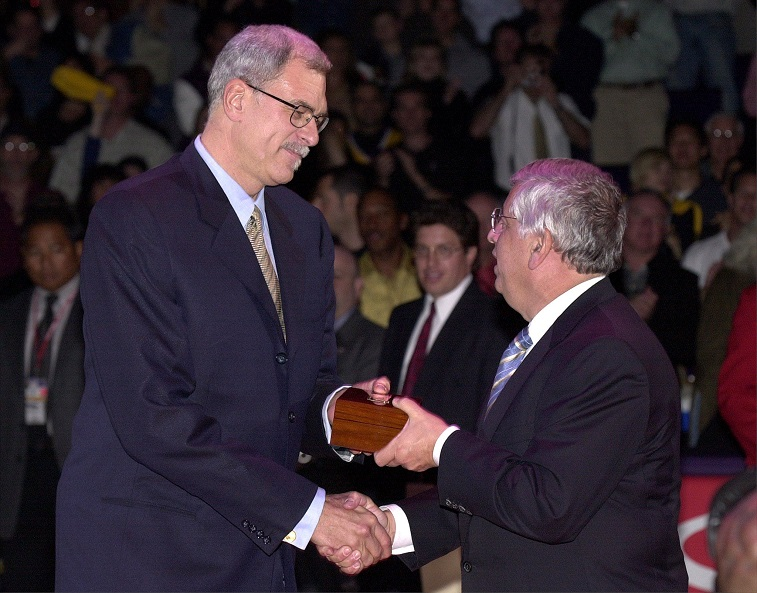 LOS ANGELES, UNITED STATES: Coach Phil Jackson of the Los Angeles Lakers (L) receives his world championship ring from NBA Commissioner David Stern in ceremony 01 November 2000 in Los Angeles. The Lakers, who won the NBA championship last season against the Indiana Pacers, played their first home game of the season against the Utah Jazz and lost, 97-92. (Electronic Image) AFP PHOTO/Vince BUCCI (Photo credit should read Vince Bucci/AFP/Getty Images)