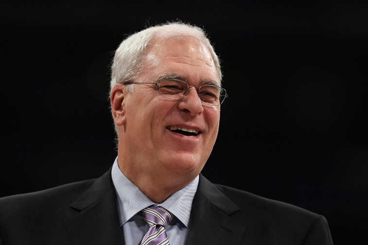 LOS ANGELES, CA - DECEMBER 03: Los Angeles Lakers head coach Phil Jackson smiles during the game against the Sacramento Kings at Staples Center on December 3, 2010 in Los Angeles, California. The Lakers defeated the Kings 113-80. NOTE TO USER: User expressly acknowledges and agrees that, by downloading and or using this photograph, User is consenting to the terms and conditions of the Getty Images License Agreement. (Photo by Jeff Gross/Getty Images)