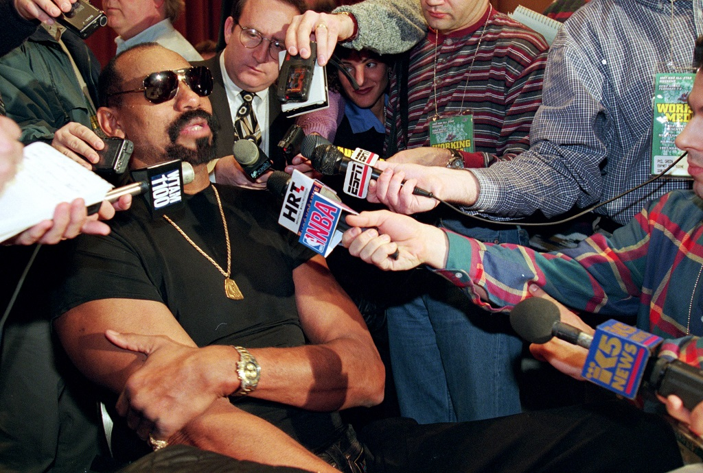 Former Los Angeles Laker Wilt Chamberlain addresses the media at a press conference.