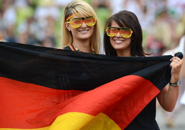 German fans with national flag attend a public screening of the FIFA World Cup