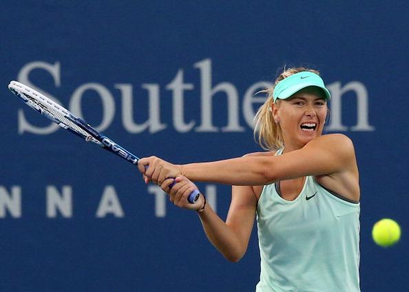 Maria Sharapova swings away.