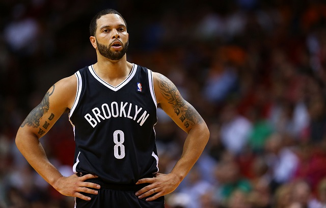 Deron Williams takes a breather between plays.