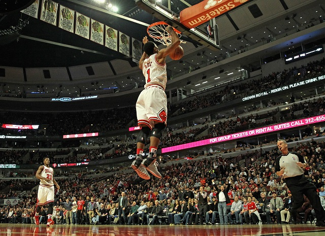 Derrick Rose goes in for a dunk.