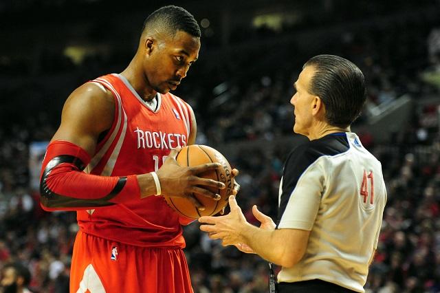 Dwight Howard talks to a referee