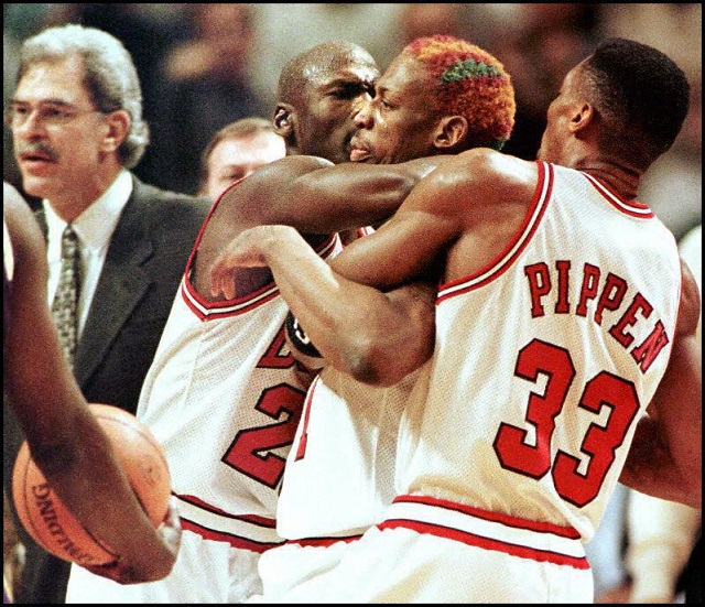 Dennis Rodman has to be restrained.