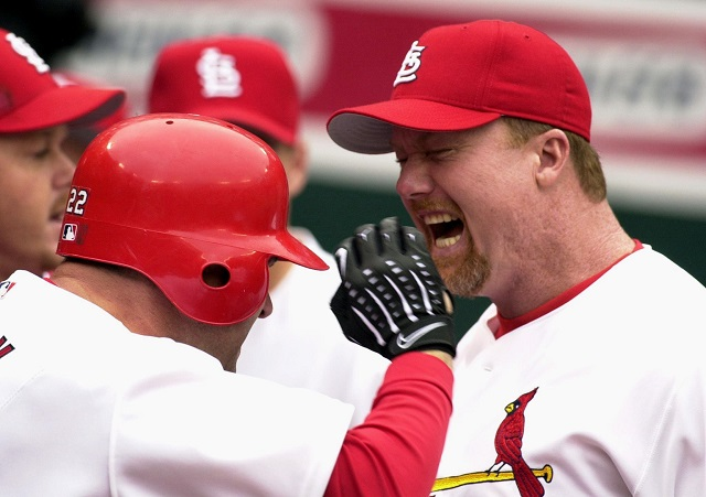 ST. LOUIS, MO - OCTOBER 5: St. Louis Cardinals' Will Clark (L) is congratulated by teammate Mark McGwire after he hit a three-run homer off Atlanta Braves starter Tom Glavine during the first inning in game two of the National League divisional playoffs 05 October 2000 in St. Louis. The Cardinals won 10-4 to take a two game lead in the series. (Photo credit should read )