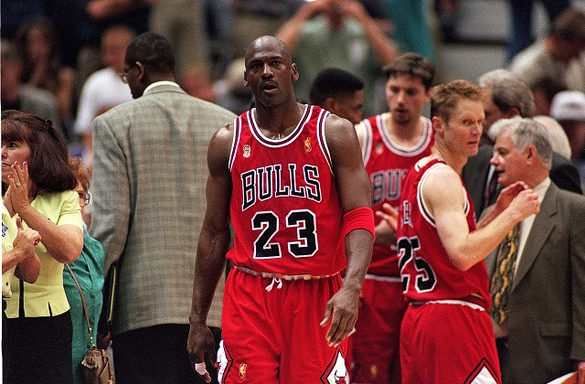 Michael Jordan walks off the court after a win.