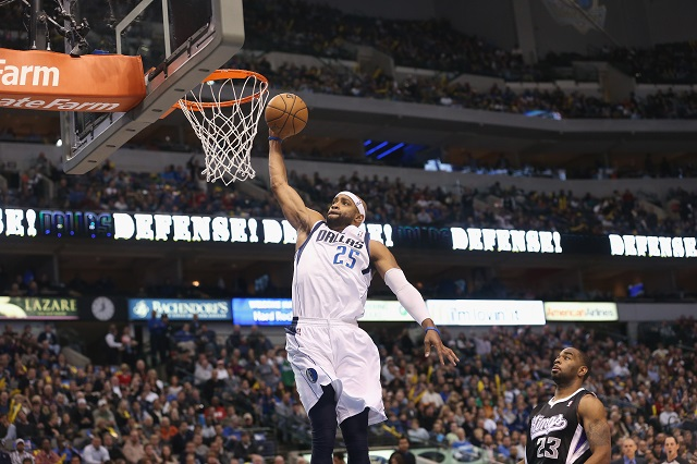 Vince Carter flies through the air for a slam dunk.