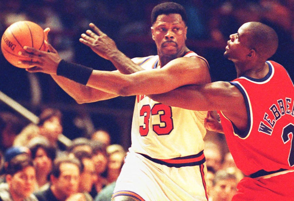 Patrick Ewing defends the ball against an opponent.