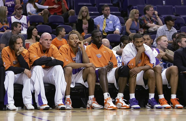 Suns players look dejected on the bench.
