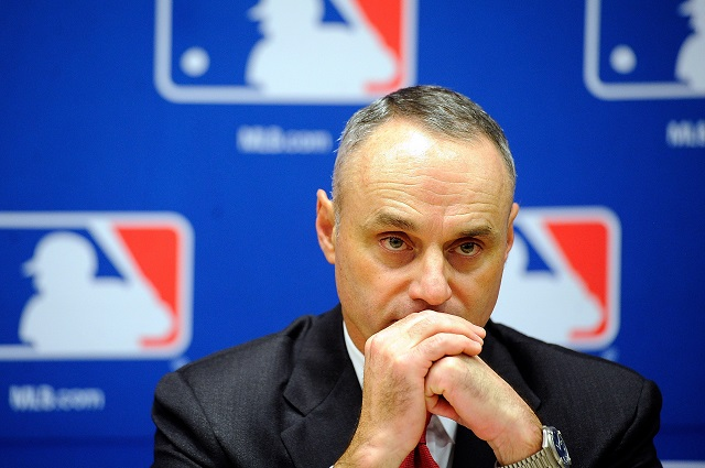 Rob Manfred sitting during a press conference.