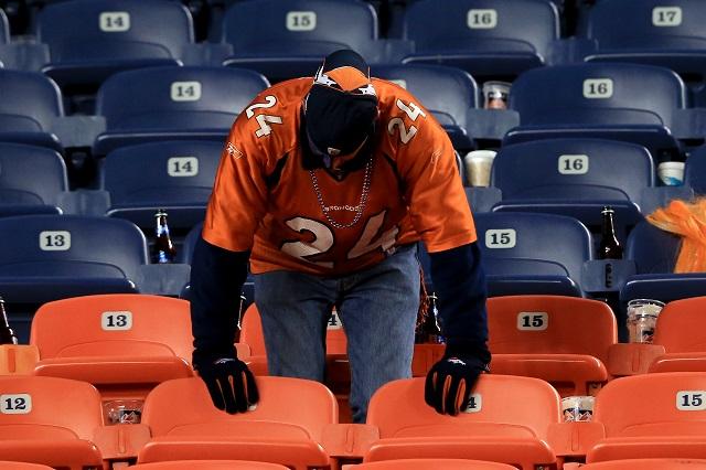 A Denver Broncos fan mourns a loss.