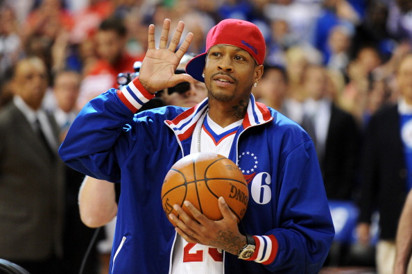 Allen Iverson stands on the sidelines before a game.