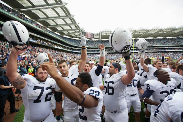 DUBLIN, IRELAND - AUGUST 30: Penn State players celebrate victory over UCF in  the Croke Park Classic American Football match between Penn State v Central Florida at Croke Park Stadium on August 30, 2014 in Dublin, Ireland.  (Photo by Patrick Bolger/Getty Images)