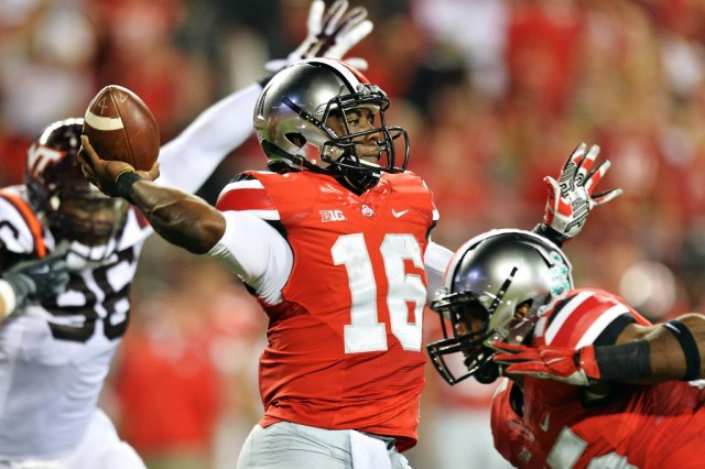 J.T. Barrett #16 throws the pass