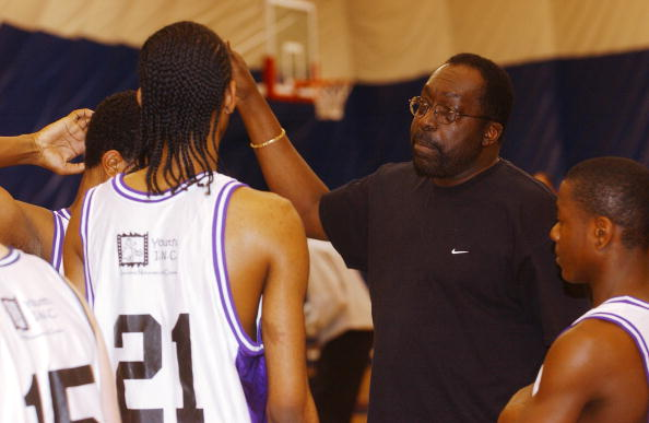 Earl Monroe coaches some young basketball players.
