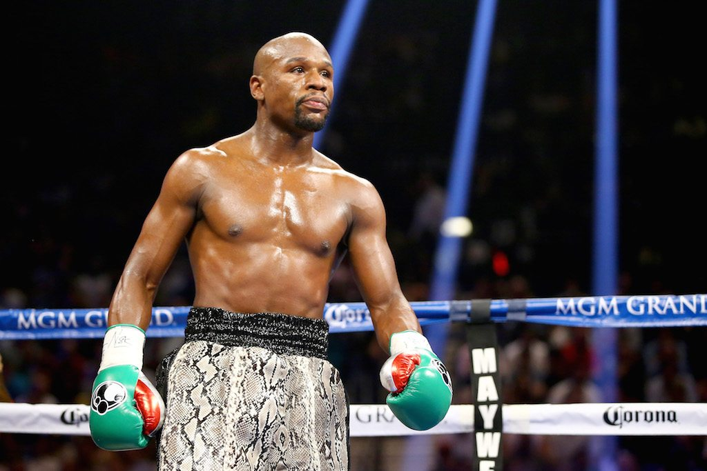 Floyd Mayweather stands in the ring during a match
