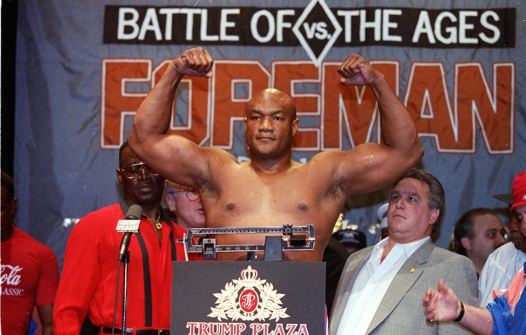 George Foreman flexes for members of the press.