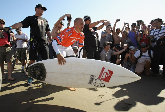 kelly slater with a surfboard