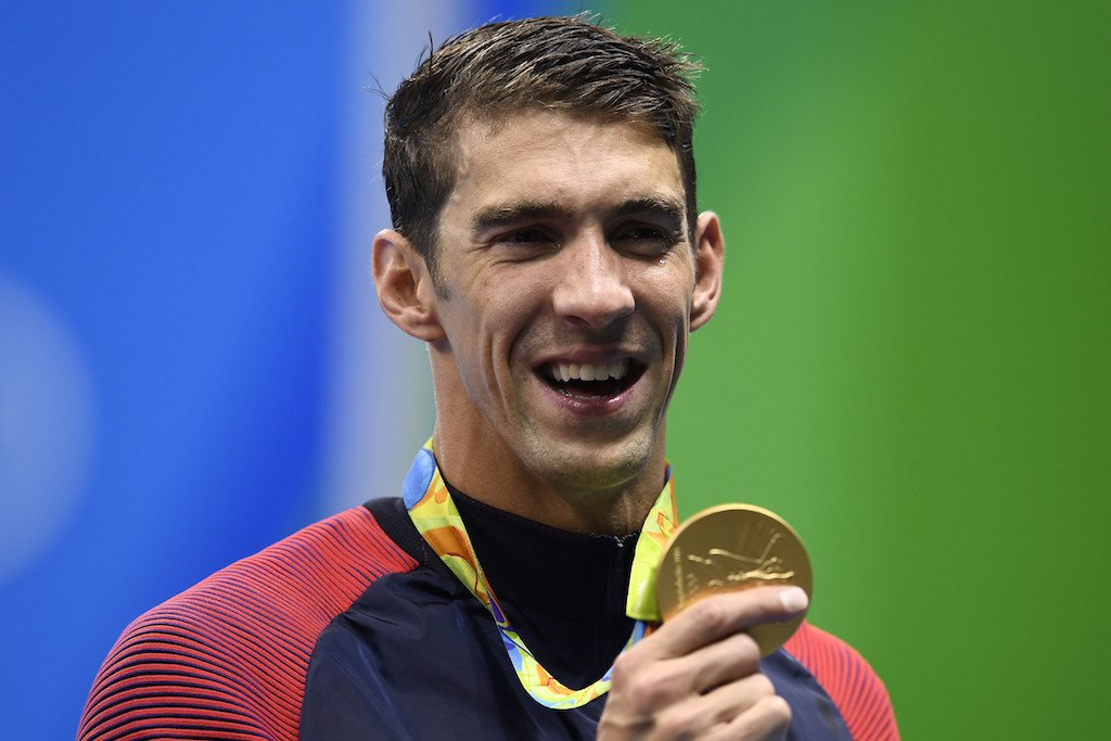 Michael Phelps shows off one of his gold medals.
