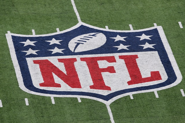 An NFL symbol on a large field.