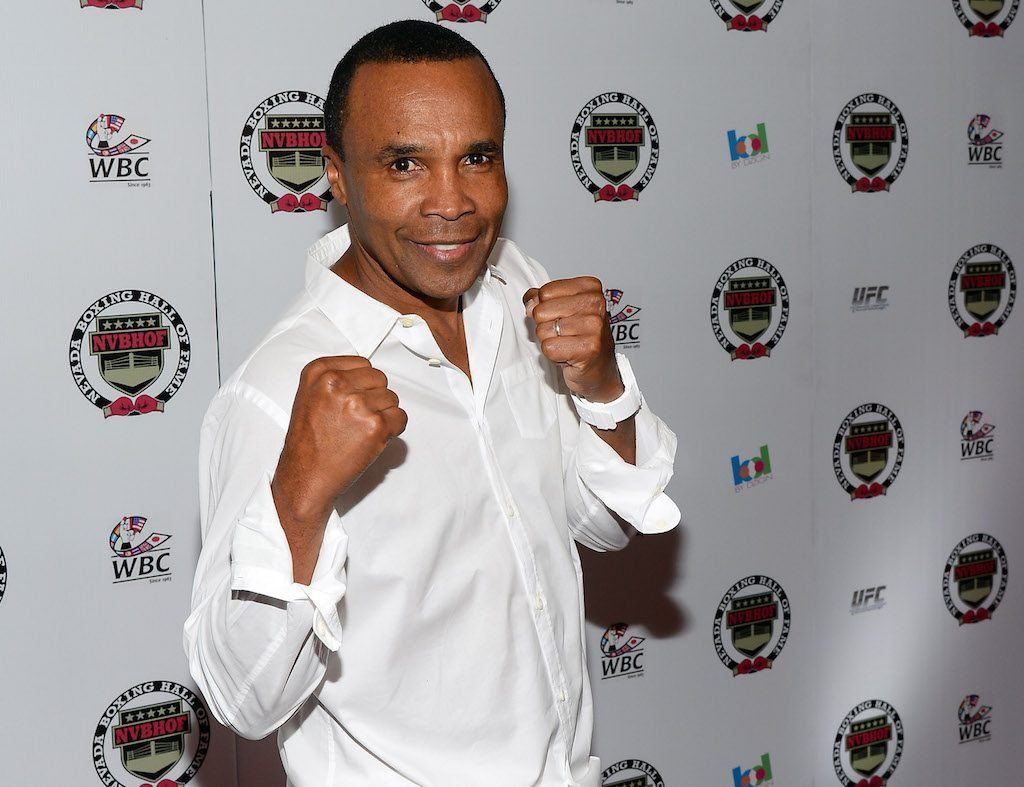 Sugar Ray Leonard holds his fists up during a media event.