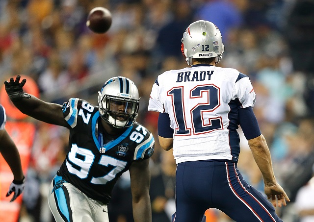 Tom Brady avoids being sacked against the Carolina Panthers.