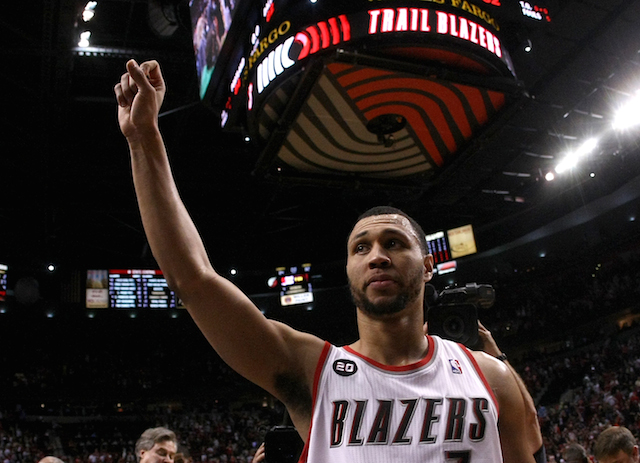 Brandon Roy raises his fist as he walks off the court.