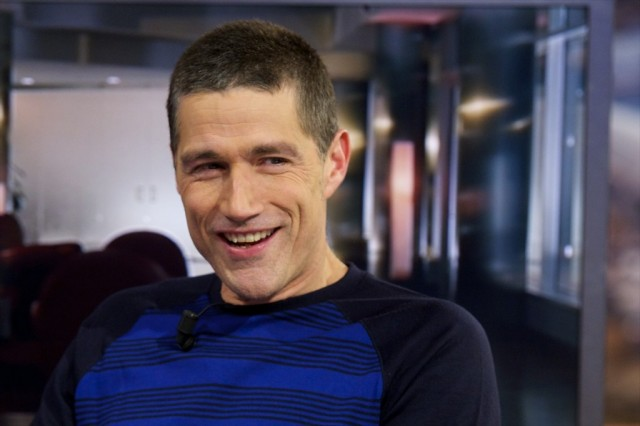 Matthew Fox smiles.