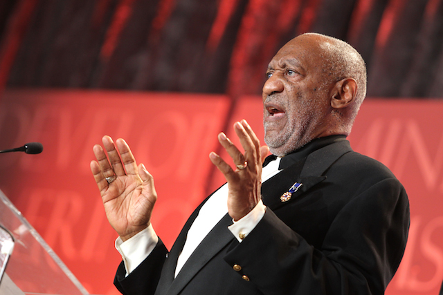 Bill Cosby addresses the audience at an awards ceremony.