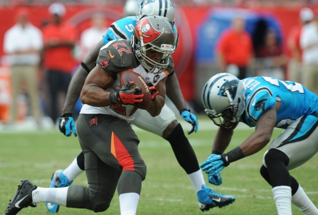 Doug Martin evades a tackle from the Carolina Panthers