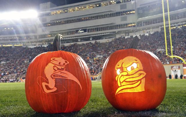 Pumpkins depict the Miami Hurricanes' Sebastian the Ibis (L) facing off against Virginia Tech's Hokie Bird during a Halloween football game