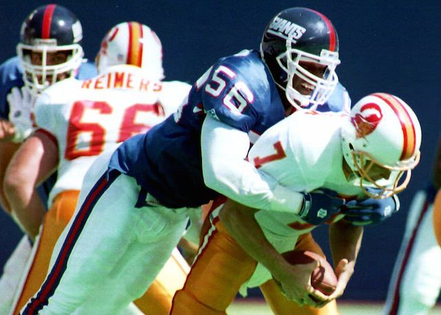 Lawrence Taylor sacking an opponent