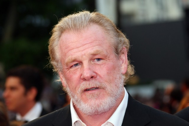 Nick Nolte talks on the red carpet.